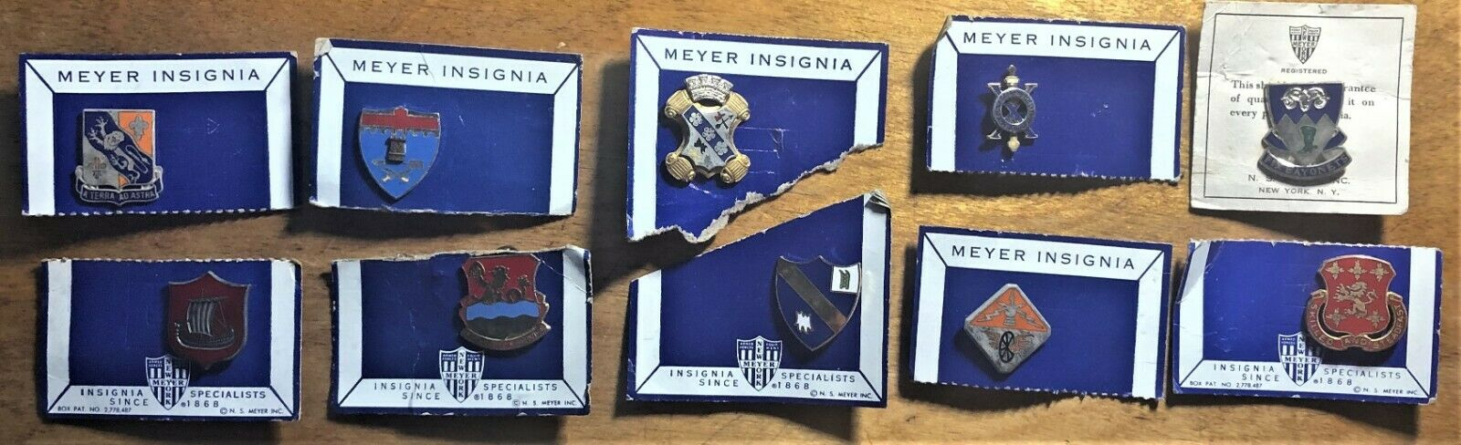 WHOLESALE - 10 (TEN) DIFFERENT N. S. MEYER NEW CONDITION CLUTCHBACK INSIGNIAS